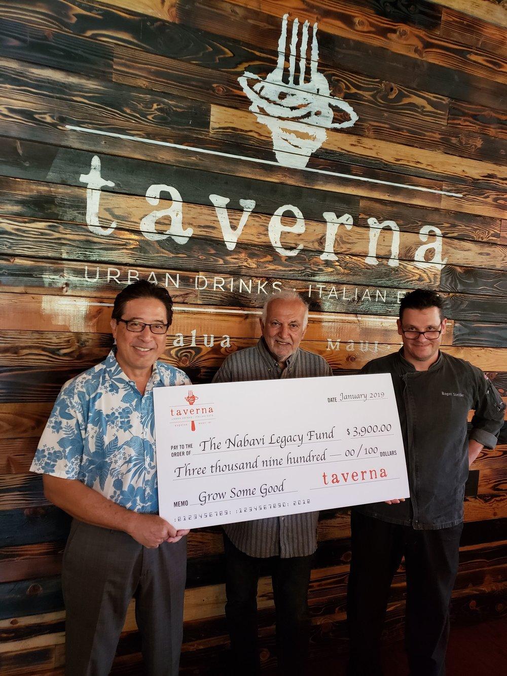 Taverna principal partner Chris Kaiwi, Nabavi Legacy Fund founder Paris Nabavi and Taverna executive chef Roger Stettler with the donation check.