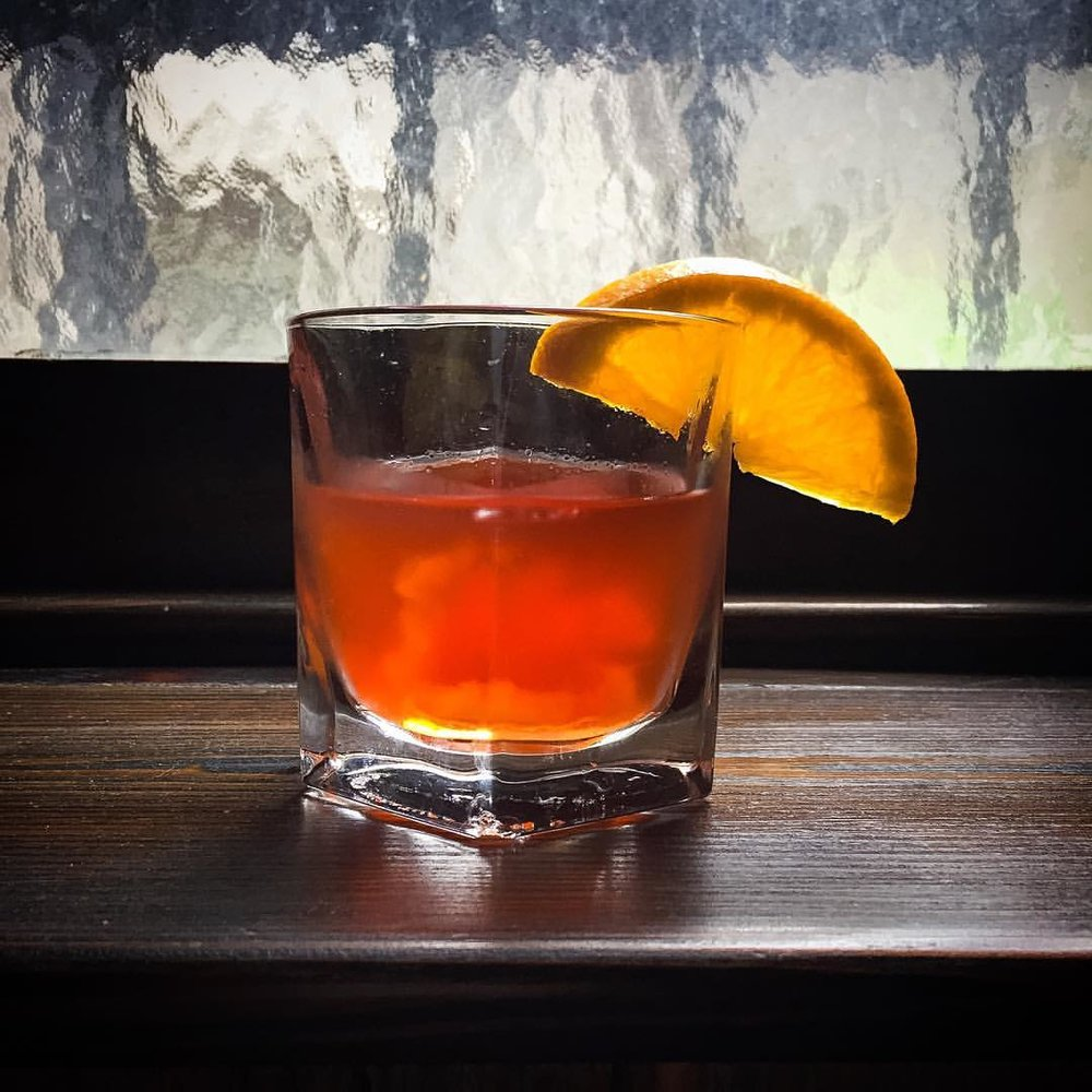 Negroni Special with apricot syrup and dried apricots