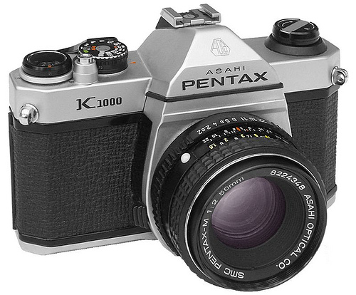 The Pentax  K1000  is an interchangeable lens, 35 mm film, single-lens reflex (SLR)  camera.  The  K1000's  sturdiness and longevity make it a camera legend.