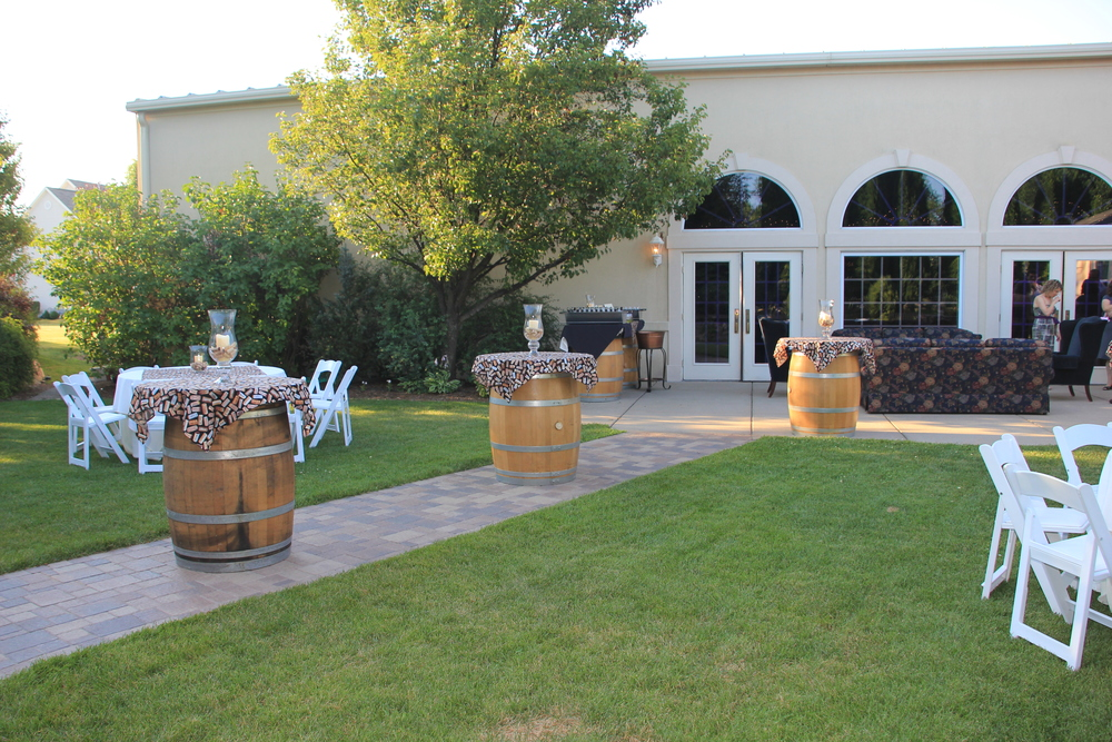 A beautiful outdoor wine themed bridal shower with wine barrels and outdoor furniture!