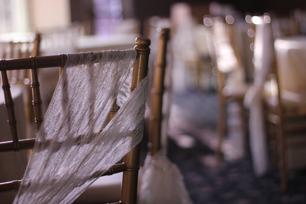 Our Gold Chivari Ballroom chairs come with the room!  Shown here with optional lace chair ties!