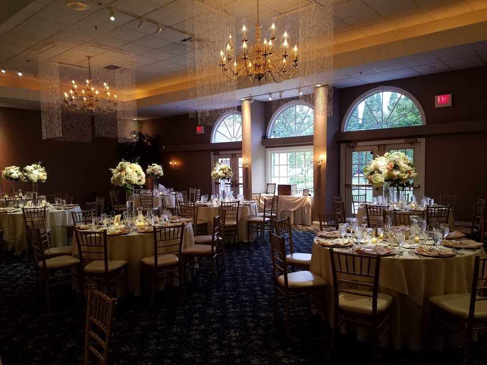 Pearl Curtains framing chandeliers (All six in the ballroom)