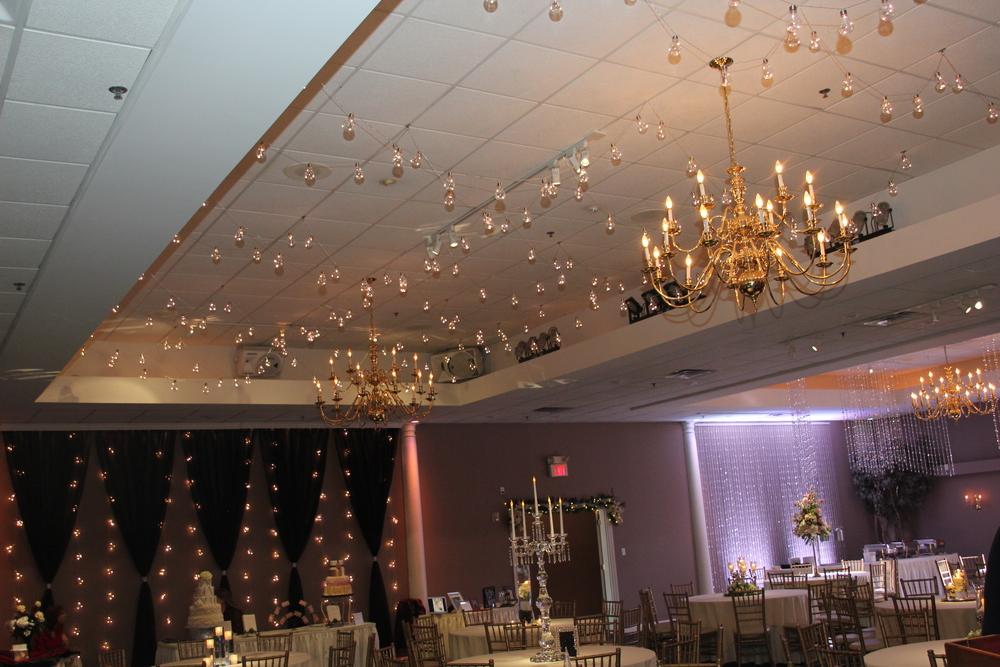 Edison light ceiling and backdrop with black voile curtains