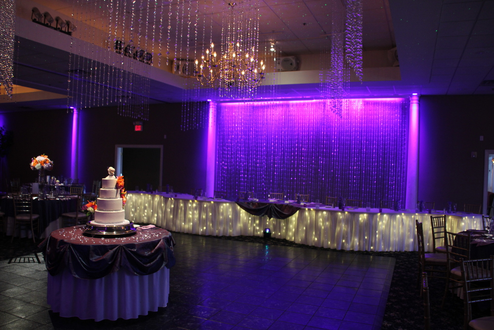 Aces and Eights ceiling and backdrop with purple downlighting