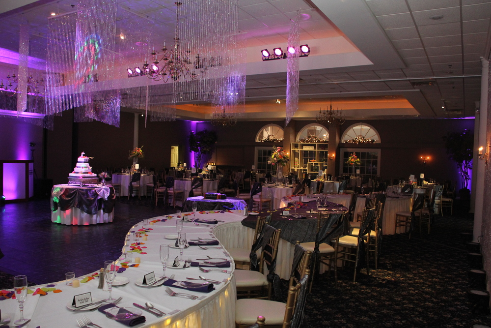 Crystal curtain ceiling with long serpentine head table and silver bichon tablecloths