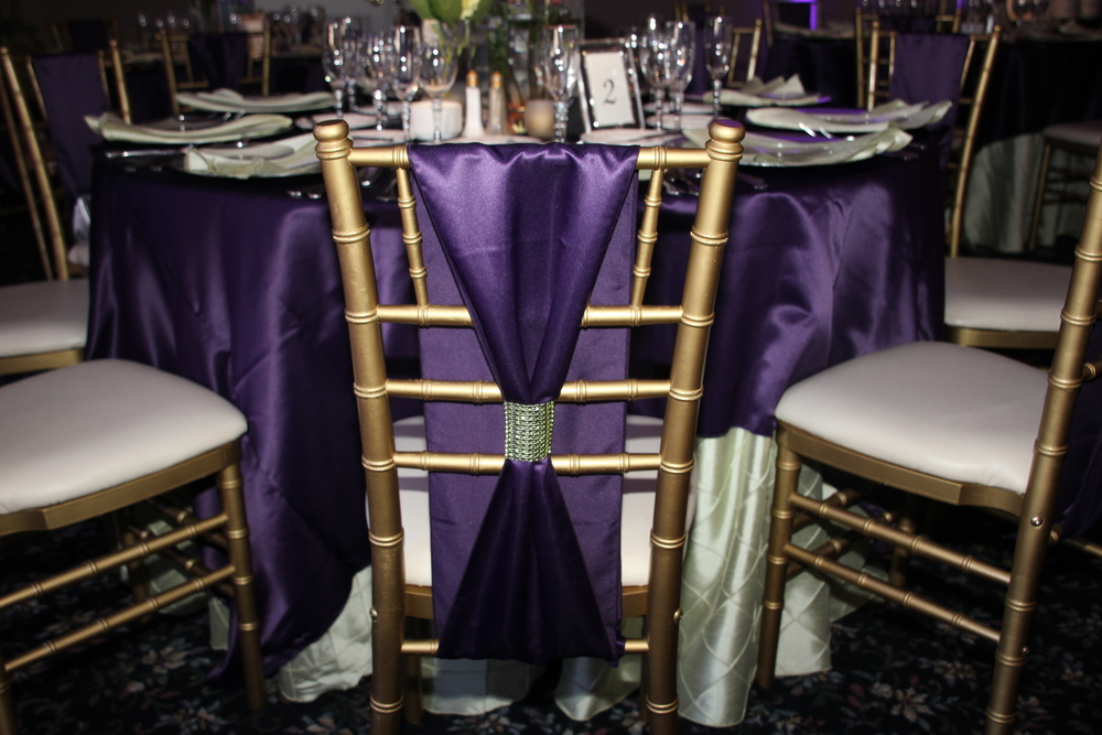 Purple Satin With Purple Satin Chair ties and sparkle bands!