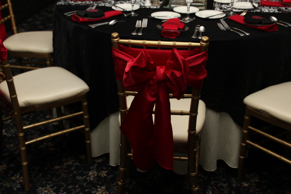 Black Satin Tablecloths with Red Satin Chair tie Bows