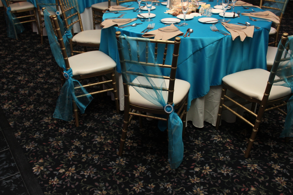 Teal Blue Satin Tablecloths with Teal Organza Chair ties (and sparkle buckles)