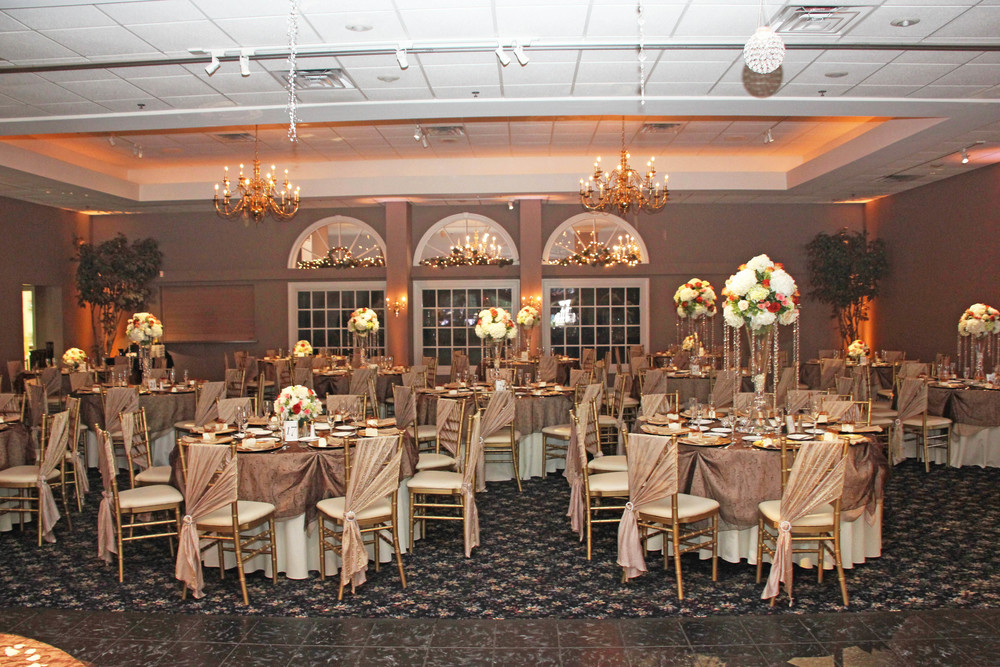 Brown Organza Swirl tablecloths with taupe chair sashes