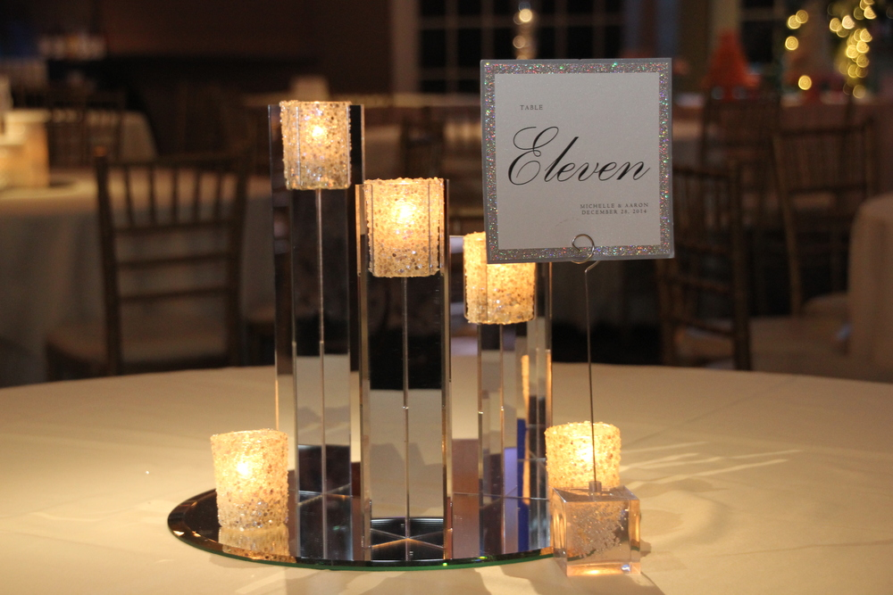 "Mirrored candle holders with ""broken glass"" votives also available with the votive color of your choice and custom Envelopments table numbers"