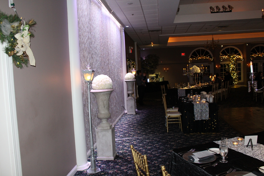 Bright white lighting on crystal curtains with stone pillars (available for rental)
