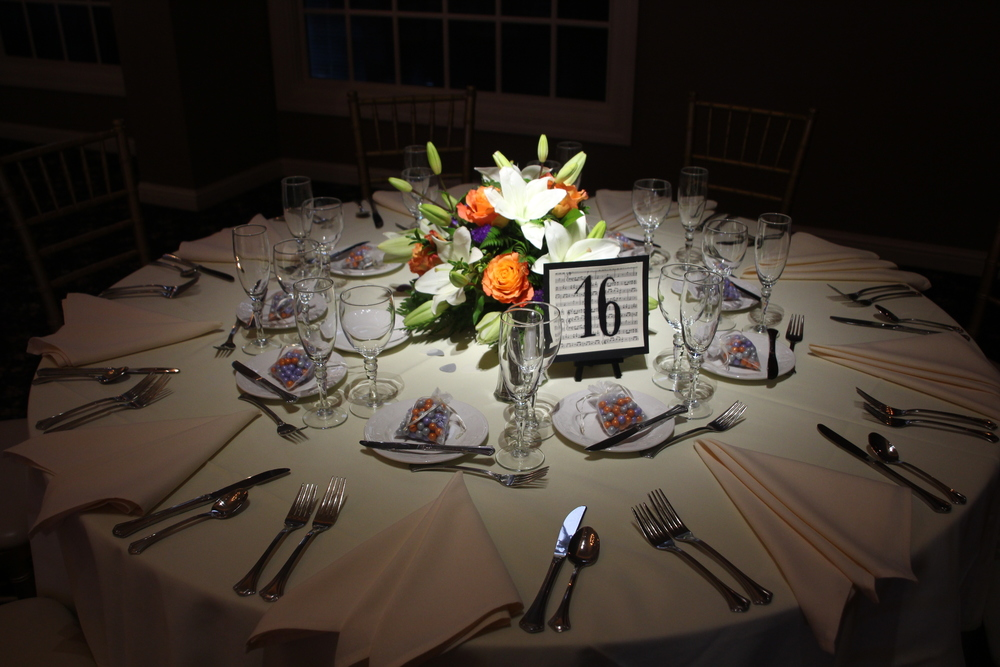 Beautiful floral centerpieces by House of Fabian on half of the tables.