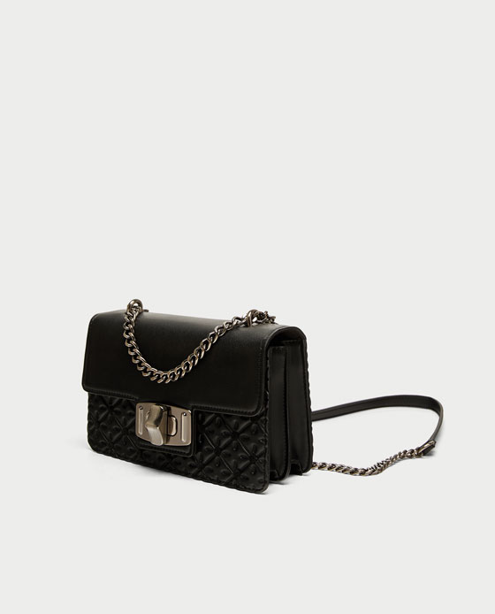 Zara Contrasting Crossbody - This bag is a nice mix of structured and classic. The quilted portion has a Channel quality about it, but the boxy shape gives it a more structured look.