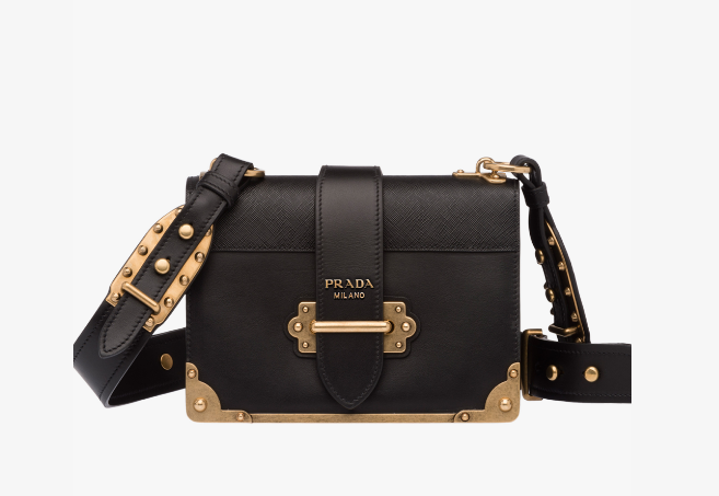 Prada Cahier  - So much admiration for the design of this bag! I love the chunky metal hardware, the wide leather strap, the metal edging!
