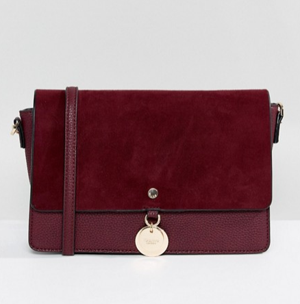 dune evania - The faux leather and suede textures look luxurious in this jewel tone!
