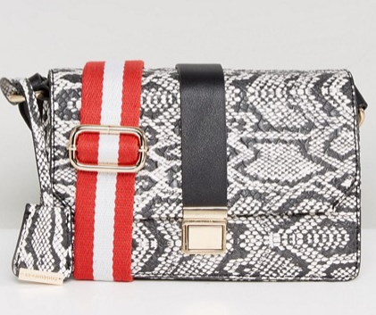 asos crossbody  - This fun bag shows off a few fun seasonal trends- 1) the guitar strap style shoulder strap 2) the incorporation of primary red 3) the sharp structure you'll see in the bags below!