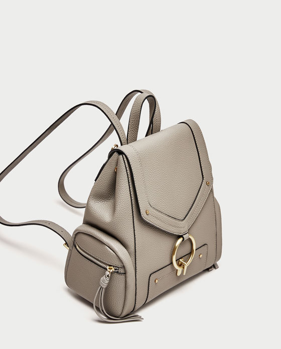 zara backpack - This fun backpack is a step up from that Jansport you had at school! The ring clasp adds a nice detail and you can't beat the practicality of wearing it on your back!