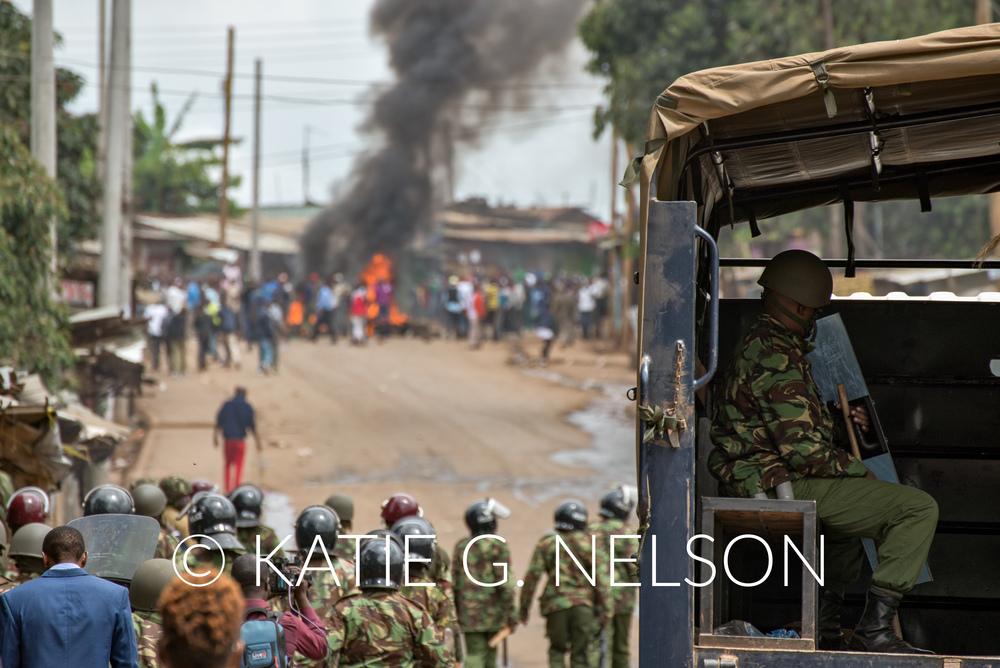 Kenyan anti-riot police approach demonstrators in the Kibera neighborhood of Nairobi, Kenya