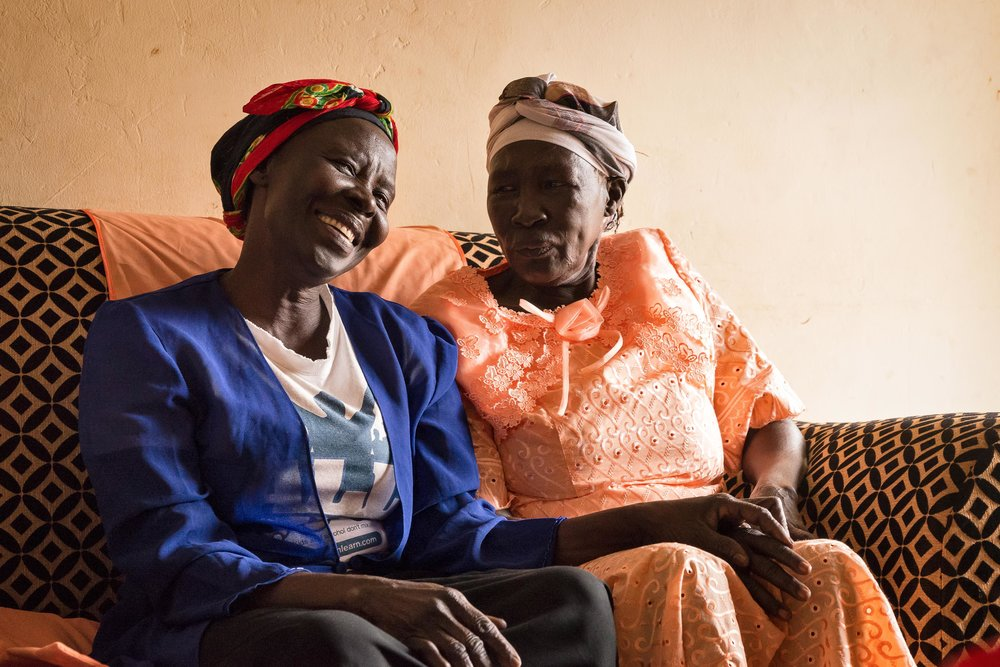 Sisters Cecilia and Norah share a couch in Arua, Uganda.