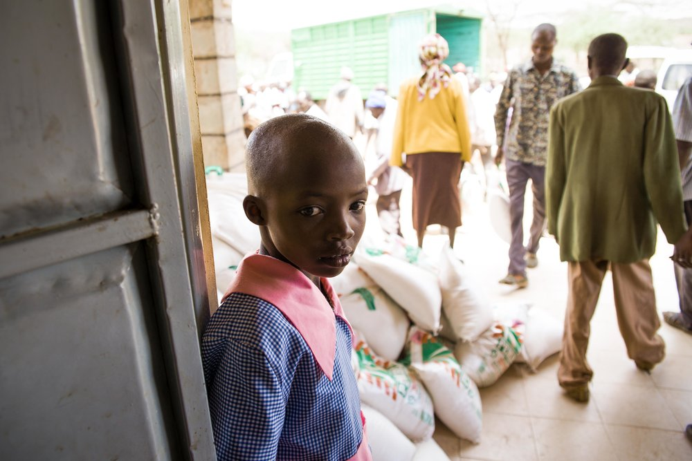 A student waits to collect her ration of emergency food relief in Baringo County, Kenya. Kenya is one of several East African countries experiencing a severe drought, which has led to widespread food insecurity throughout the region. Photo: Katie G. Nelson