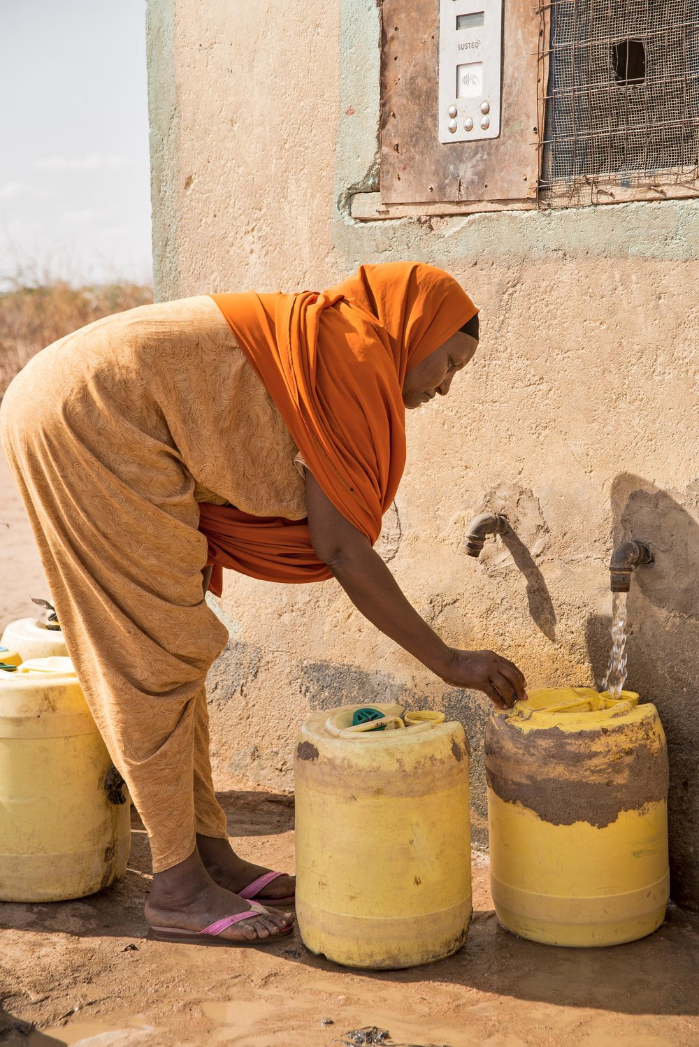 Bishara Abdiladir, 53,  collects water from a Water ATM in Hadado Town in Nothern Kenya. She said she typically makes four trips to the Water ATM everyday.