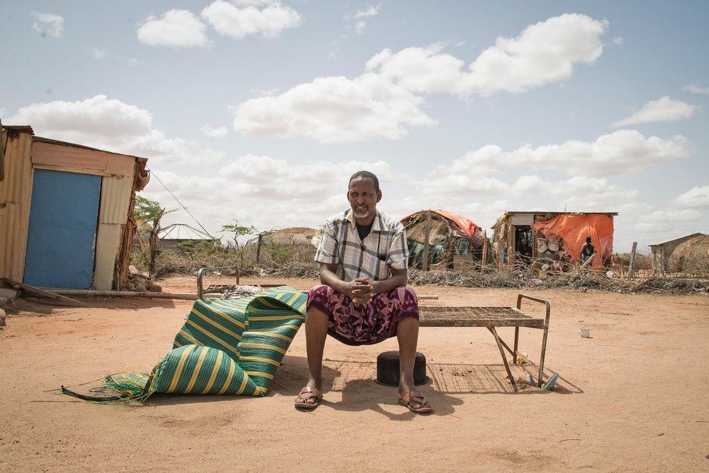 Abdulahi Yusef, 40, waits near his shop in Hadado Town, Northern Kenya.  An ongoing drought in the Horn of Africa has drained underground water tables in the region. Yusef maintains one of the only sources of water in the remote town; a Water ATM sponsored by Oxfam UK.