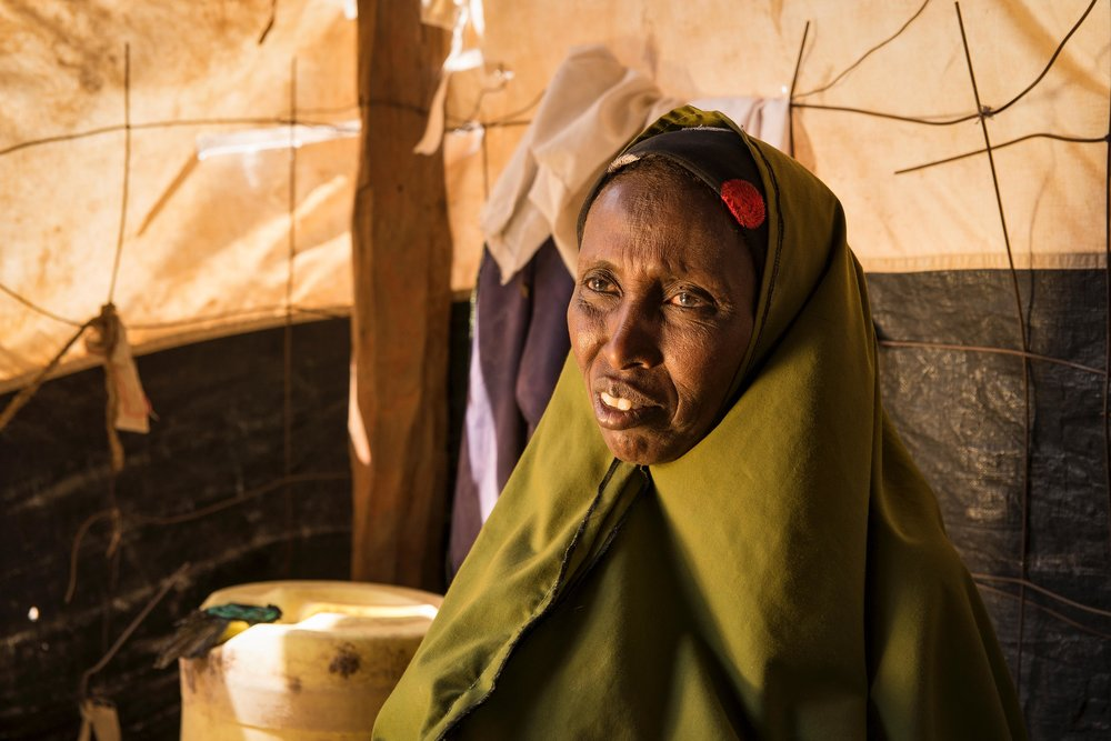 "Haretha Muhaumud, 47, sits in her home in Hadado Town, Northern Kenya. Oxfam's water ATMs provide access to reliable and affordable clean water in towns across northern Kenya, a commodity that is increasingly difficult to find due to the ongoing drought in the region. The Water ATM's ""have really transformed my life,"" said Muhaumud. ""Now, the water is very much close and it has helped me very much."""