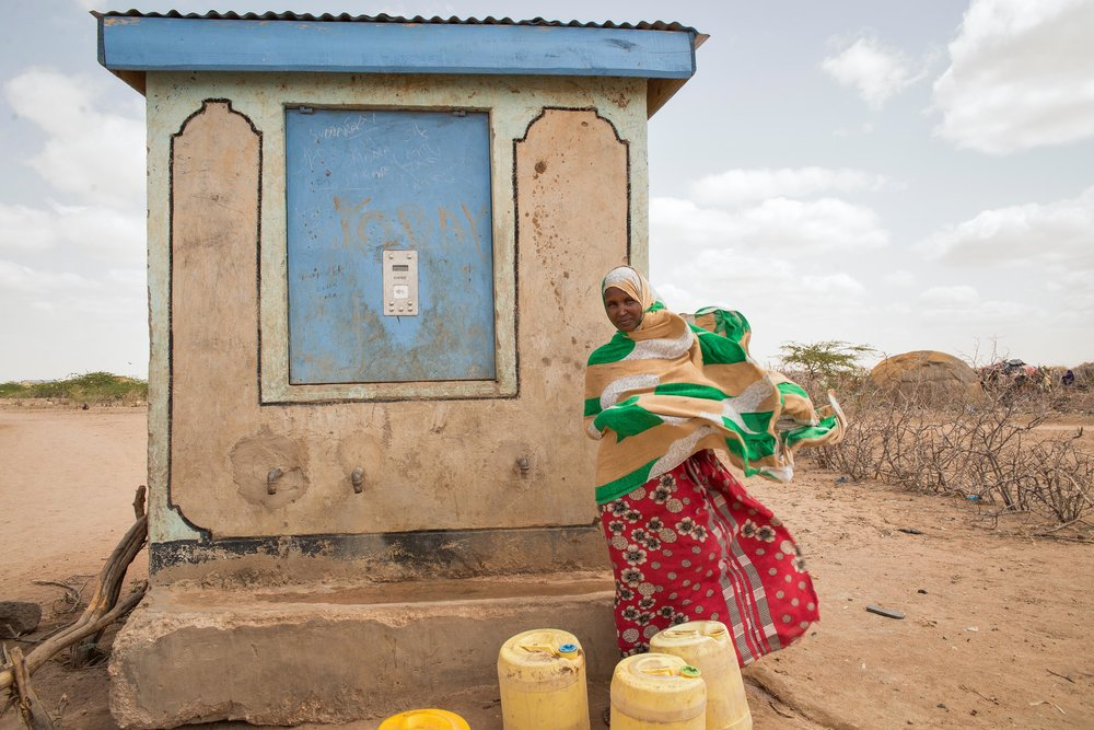 Rukia Billow, 24, collects water several times a day from a kiosk in Hadado Town, Northern Kenya. The kiosk, which distributes 20 liters of clean water for about .20 cents, provides a lifeline for many families during the ongoing drought in the region. But this water is still too costly for many mothers, whose sole source of income is the livestock that left with their husbands months before.