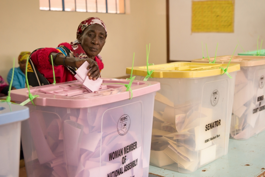 An elderly woman submits her ballot at Kibera Primary School in Nairobi. Many voters withstood long lines and slow registration technology to vote in Tuesday's elections. Katie G. Nelson