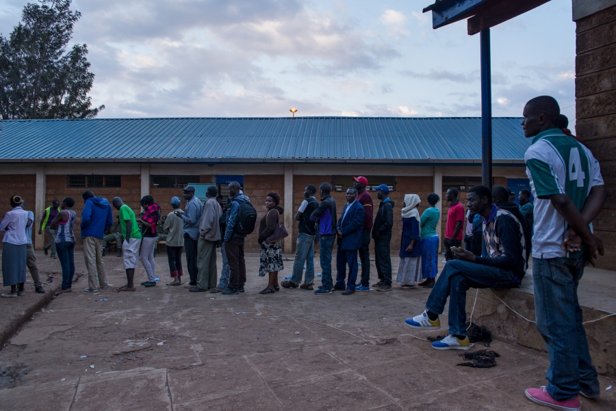 Kenyans stood in lines late into Tuesday night in order to cast their vote for their next president. Technical hangups, mis-delivered ballots and weather delays mean voters several counties will continue submitting ballots late into the night. Katie G. Nelson
