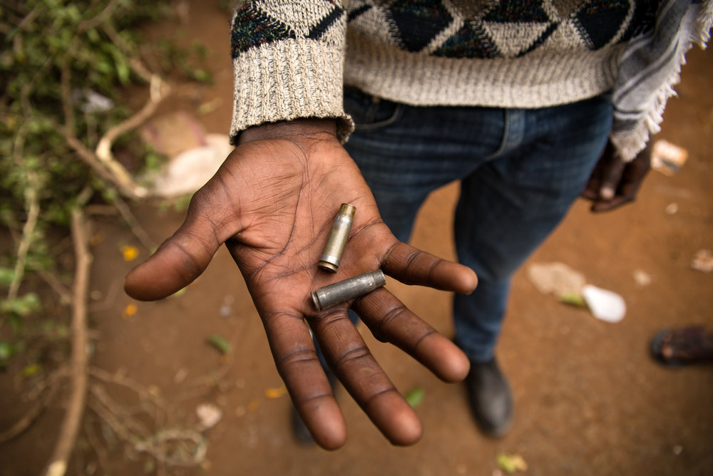 A man holds bullet casings marked with the Kenya Defense Force stamp in Nairobi, Kenya.