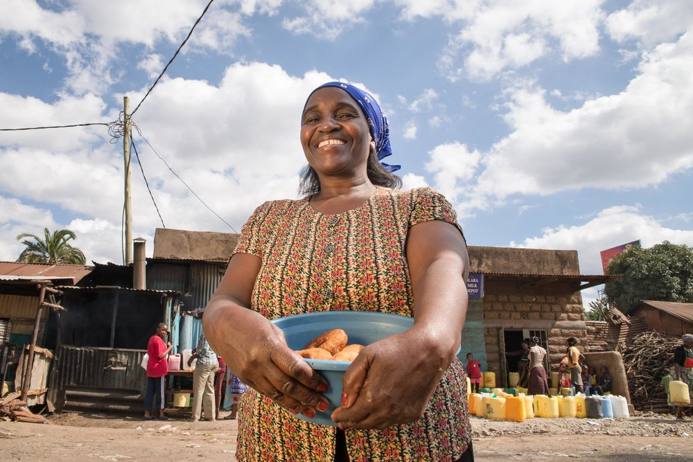 A portrait of Susan Wairimu, a 50-year-old baker in Kawangware, an informal settlement in Nairobi, Kenya. Oxfam, 2017.