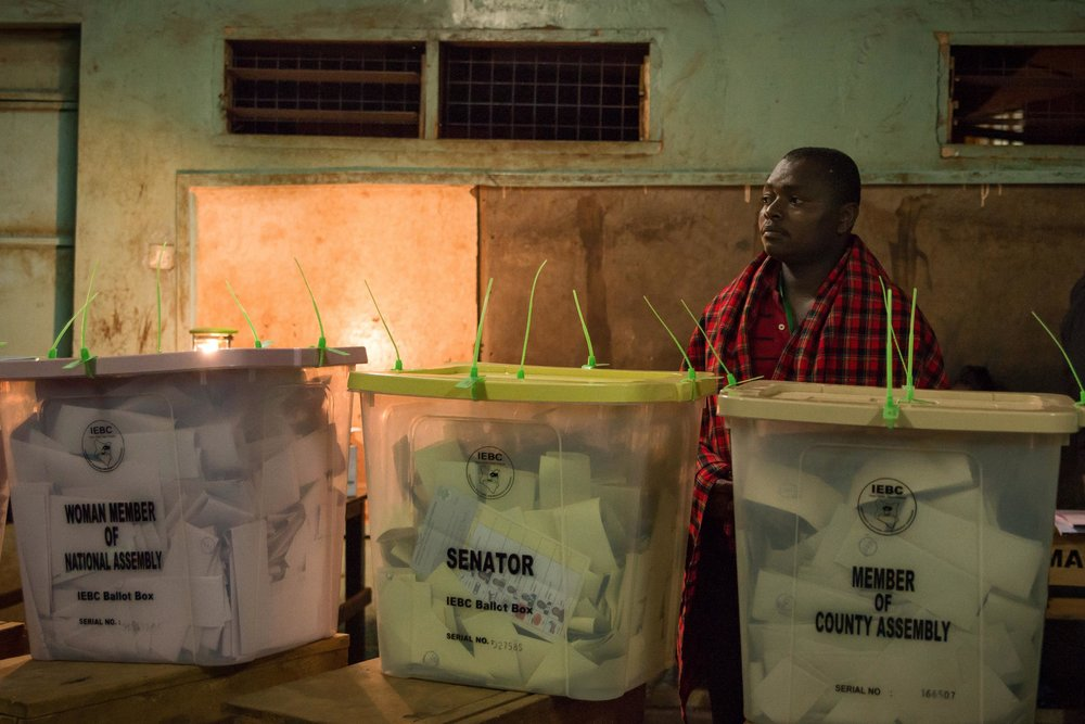 An election official wait for confirmation to begin counting votes for Kenya's next president in Nairobi, Kenya. Public Radio International, August 2017.