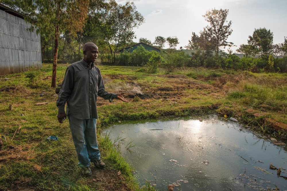 Maurice Juma Ojaoro of Crocodile CBO gives visitors a tour of his farm in Homa Bay County, western Kenya. Ojaoro was disabled by a crocodile attack several years ago and now trains other farmers with disabilities how to fish and grow plants.