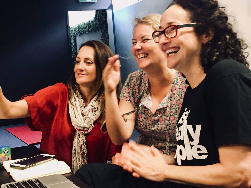 Caroline Dunphy, Director (left). Kathryn Kelly, Dramaturg (centre), and Katherine Lyall-Watson (writer) on the floor devising 'Rovers'.