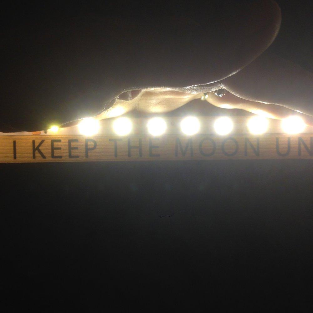 I KEEP THE MOON UNDER MY DRESS, text, LED, wood, 2017
