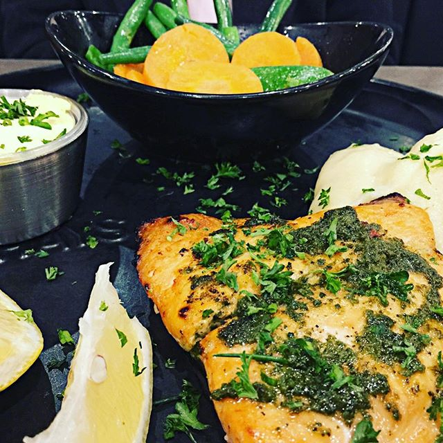 This salmon fillet with fresh herb chimichurri and Hollandaise sauce was cooked perfectly - with a lightly crisped top revealing tender juicy flesh - at Rashays in Punchbowl Sydney #salmon #vegetables #mash #restaurant #sirandmladyinvited #fish #eat #seafood #delicious #tasty #rashays #punchbowl #sydneyfoodblogger #sydney #sydneyfood