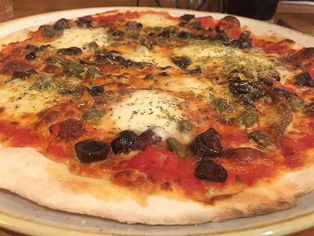 Pizza weather? Then this tasty  Alle pizza - topped with pizza sauce, mozzarella, fior di latte, Sicilian anchovies, capers, black olives and oregano would be perfect - from 11 Inch Pizza in Melbourne CBD #pizza #eat #italianfood #anchovies #cheese #restaurant #dinner #melbourne #delicious #tasty #sydneyfoodblogger #italian