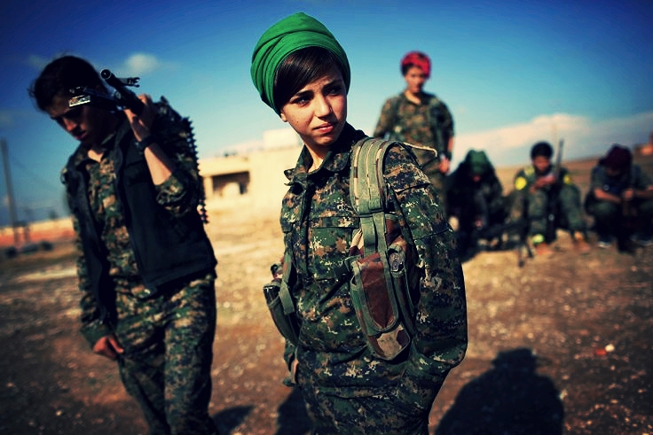10 November 2015: Kurdish female troops from the Syrian Democratic Forces stand in a forward operating base overlooking the frontline near the Isis-held town of Hole (Getty Images)