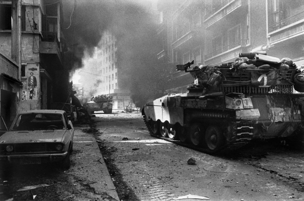 © Micha Bar Am/Magnum Photos: West Beirut. Lebanon. 1982. Tanks of the Israeli Army breaking through into the west part of the city.