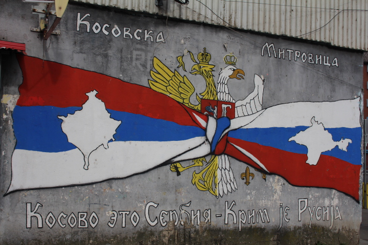 © Matthew Williams/The Conflict Archives: Is Kosovo the next country Russia aims to destabilise? 'Kosovo is Serbia and Crimea is Russia.' reads graffiti art in Mitrovica's town centre in the Kosovar Serb-part of town