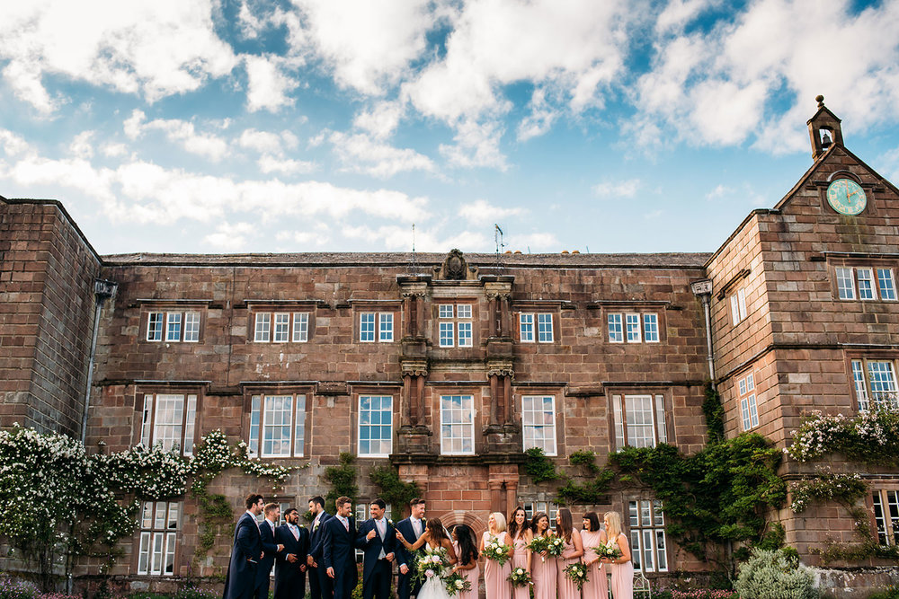 colour photo of bridal party in front of Browsholme hall