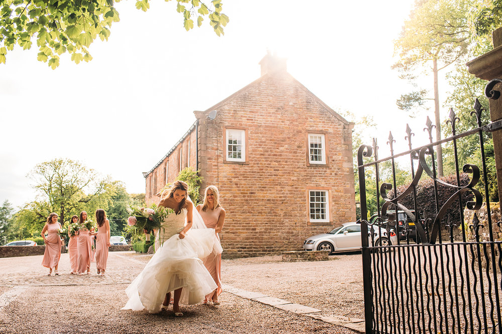 colour photo, bride and bridesmaids walking