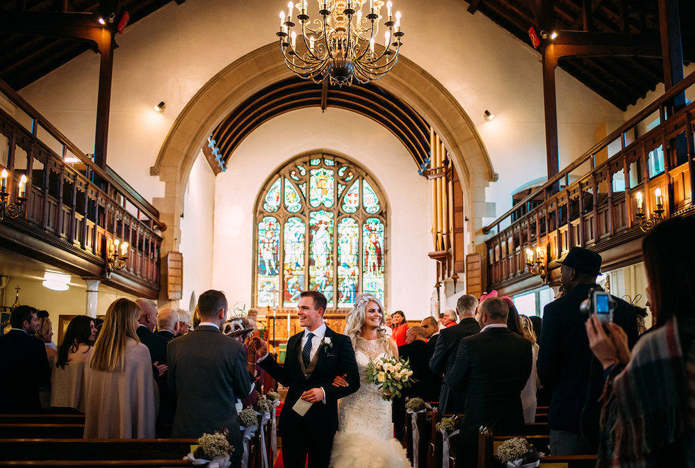 bride and groom leave church