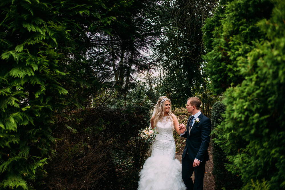 Bride and groom walking through the grounds