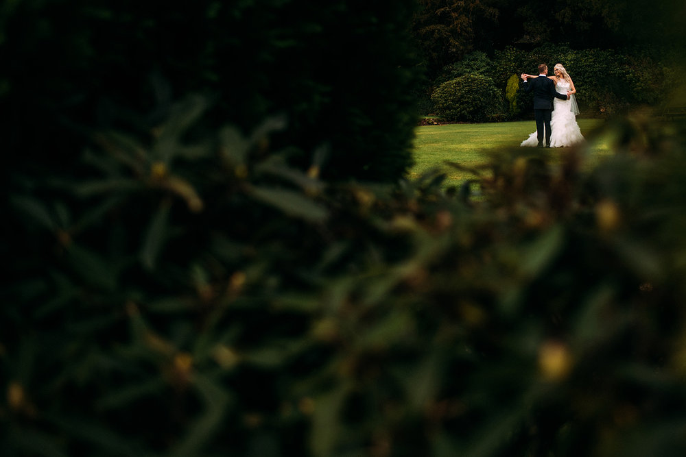 bride and groom dancing in grounds of Eaves hall