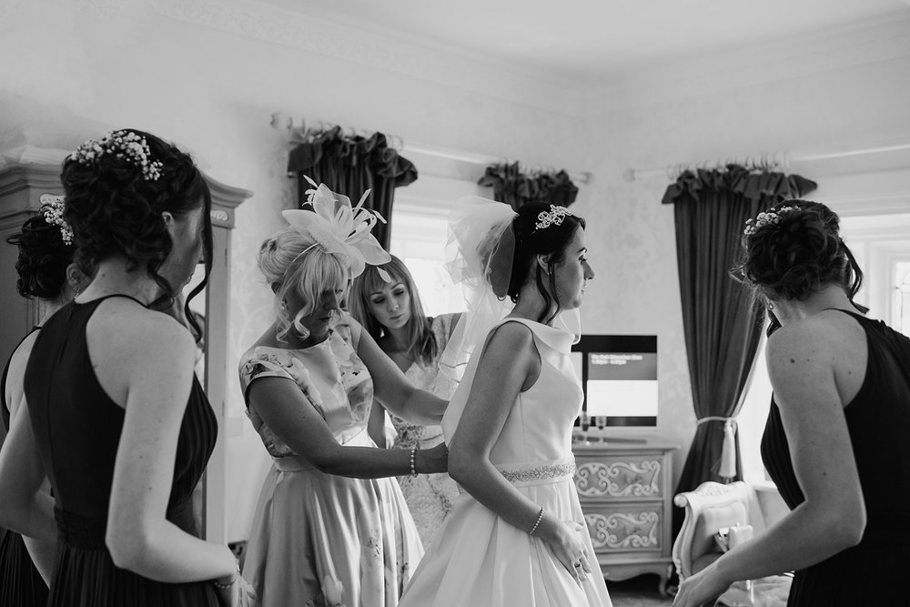 bride dress being fastened up