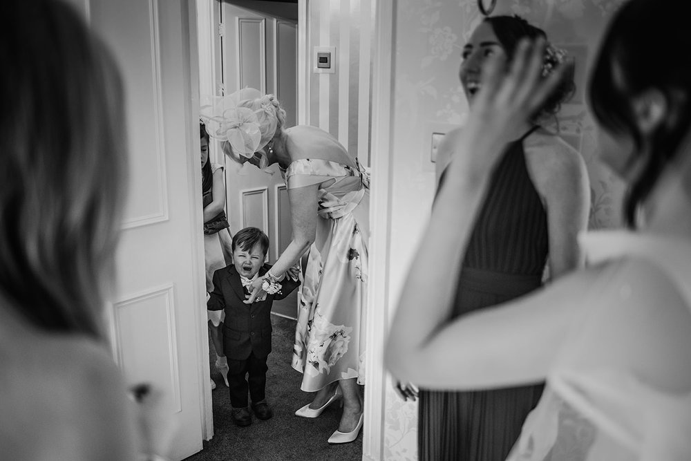 bride's son crying as he see's his mum in a dress