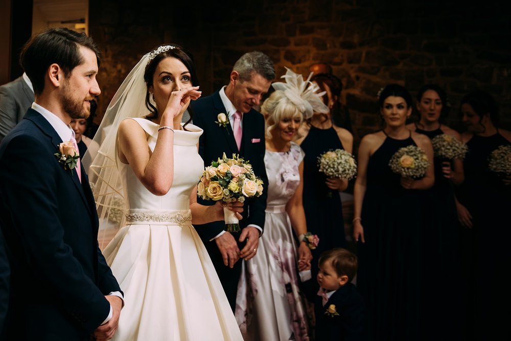 emotional bride in ceremony