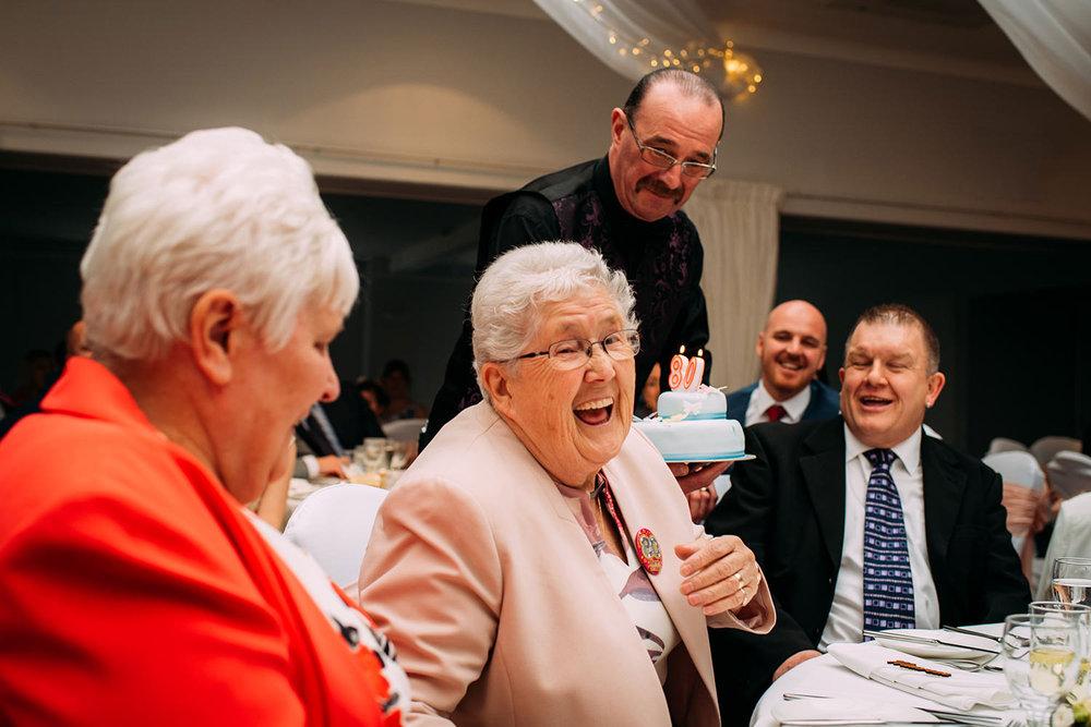 grandma getting a birthday cake